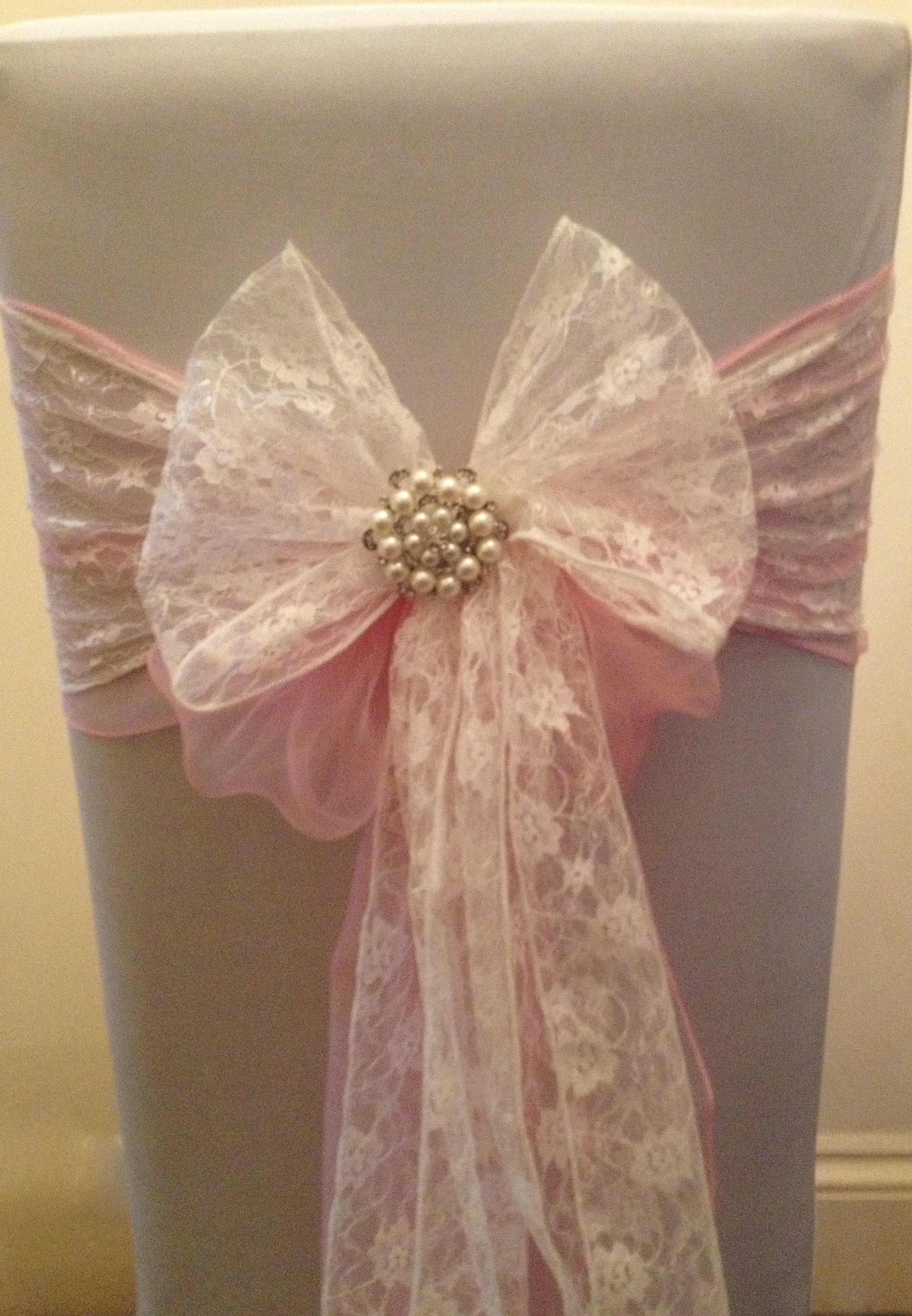 organza & lace sash with pearl brooch Something Borrowed Hire